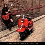 tia-travellin-with-my-guitar